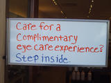 [Sign: Care for a complimentary eye care experience? Step inside]