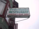 [sign: Deutschlander Restaurant, European and Asian foods]