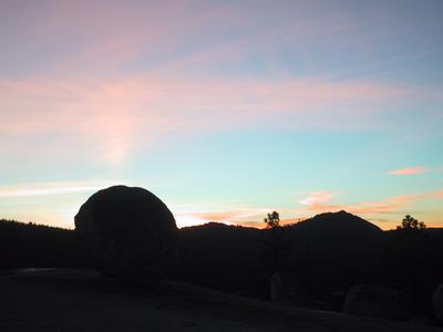 [Sunset over rocks and hills]