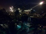 [Hotel Du Port, at night, Coutonou Benin Africa, An oasis in a shipyard]