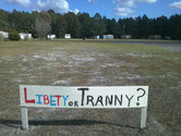 [Sign reading 'Libety or Tranny']